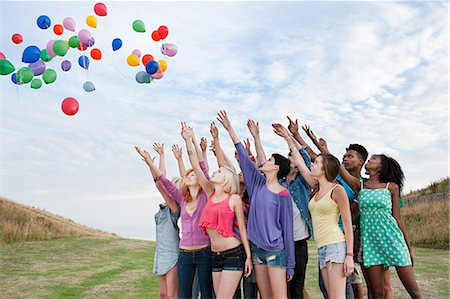 release - Young people releasing balloons Stock Photo - Premium Royalty-Free, Code: 6114-06599827