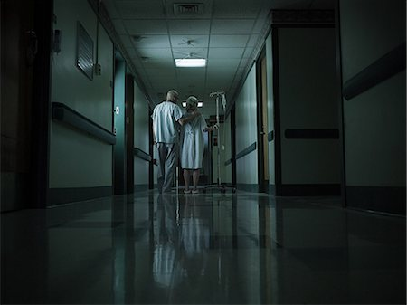 patient walking hospital halls - Female patient with intravenous drip Stock Photo - Premium Royalty-Free, Code: 6114-06599991