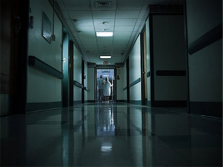 patient walking hospital halls - Female patient with intravenous drip Stock Photo - Premium Royalty-Free, Code: 6114-06599997