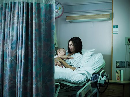 Mother with nerwborn baby in hospital Stock Photo - Premium Royalty-Free, Code: 6114-06599995