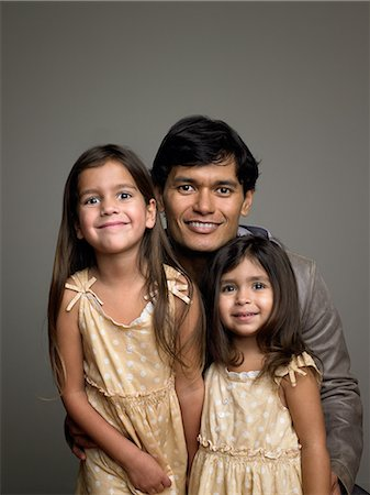 Father and daughters Stock Photo - Premium Royalty-Free, Code: 6114-06646132