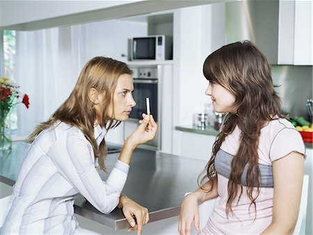 Girl and mother with cigarette Stock Photo - Premium Royalty-Free, Code: 6114-06647221