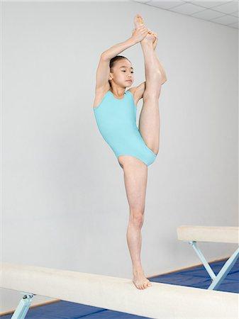 feet gymnast - Girl on a balance beam Stock Photo - Premium Royalty-Free, Code: 6114-06647669