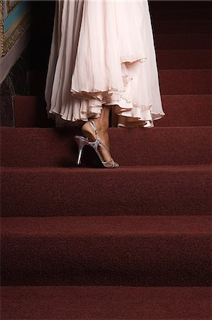 A woman walking up a set of stairs Stock Photo - Premium Royalty-Free, Code: 6114-06649388