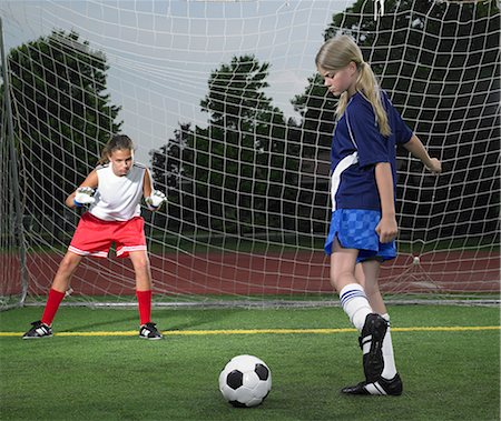 preteen girl feet - A footballer kicking a ball Stock Photo - Premium Royalty-Free, Code: 6114-06650306
