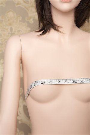 Tape measure on a mannequins breasts Stock Photo - Premium Royalty-Free, Code: 6114-06650481