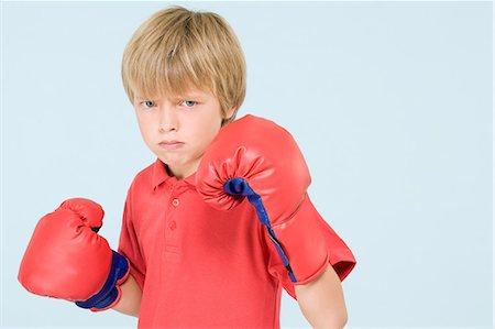 Boy boxing Stock Photo - Premium Royalty-Free, Code: 6114-06651043
