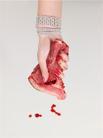 dripping blood - Woman grasping raw meat Stock Photo - Premium Royalty-Free, Code: 6114-06651996