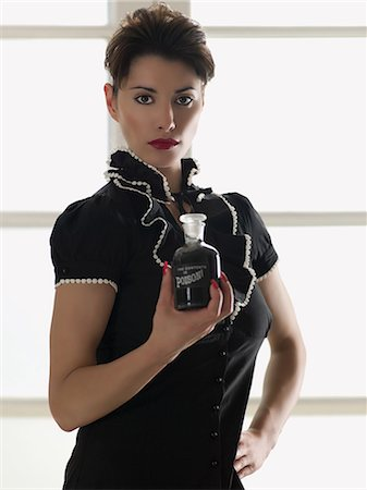 poison - Woman holding a bottle of poison Stock Photo - Premium Royalty-Free, Code: 6114-06652009
