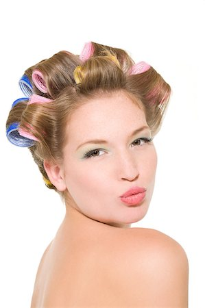 Pouting woman in curlers Stock Photo - Premium Royalty-Free, Code: 6114-06652022