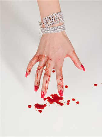 dripping blood - Woman with blood dripping from her hand Stock Photo - Premium Royalty-Free, Code: 6114-06652024