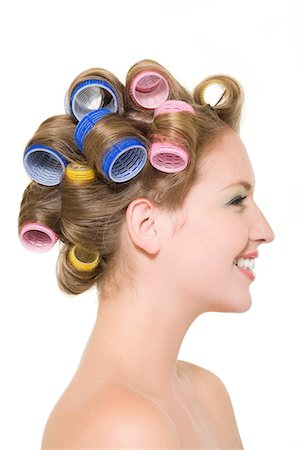 Young woman wearing curlers Stock Photo - Premium Royalty-Free, Code: 6114-06652032