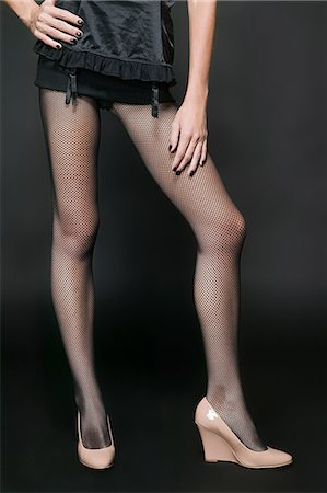 stocking feet - A woman wearing lingerie Stock Photo - Premium Royalty-Free, Code: 6114-06652142