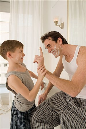 father son bath - Father and son with shaving cream Stock Photo - Premium Royalty-Free, Code: 6114-06654812