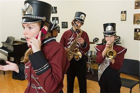 Girl on cellphone in band practice Stock Photo - Premium Royalty-Free, Code: 6114-06656459