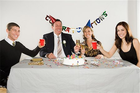 family image and confetti - Family retirement party Stock Photo - Premium Royalty-Free, Code: 6114-06657415