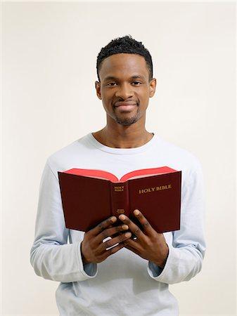 Man holding a bible Stock Photo - Premium Royalty-Free, Code: 6114-06657851