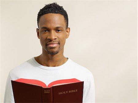 Man holding a bible Stock Photo - Premium Royalty-Free, Code: 6114-06657825