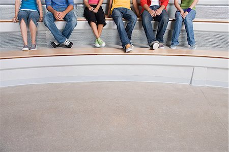 Young people sitting on a step Stock Photo - Premium Royalty-Free, Code: 6114-06658290
