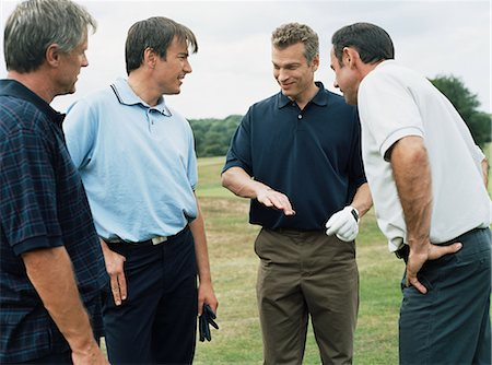 Rear view of four golfers Stock Photo - Premium Royalty-Free, Code: 6114-06658586