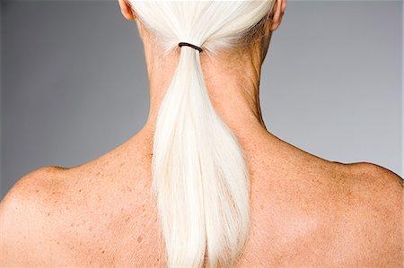 Senior woman with ponytail Stock Photo - Premium Royalty-Free, Code: 6114-06660336