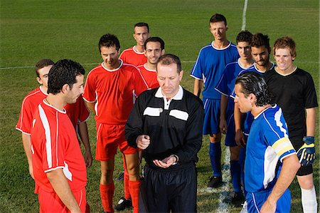 Referee tossing coin Stock Photo - Premium Royalty-Free, Code: 6114-06660946