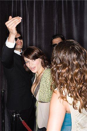 queue club - Woman in nightclub queue Stock Photo - Premium Royalty-Free, Code: 6114-06662164