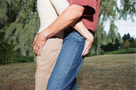 Couple gripping each other's buttocks Stock Photo - Premium Royalty-Free, Code: 6114-06663127
