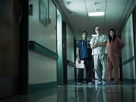 Hospital staff standing in corridor Stock Photo - Premium Royalty-Free, Code: 6114-06600002