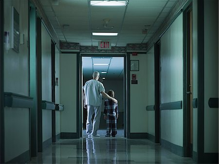 patient walking hospital halls - Male nurse and young boy in hospital corridor Stock Photo - Premium Royalty-Free, Code: 6114-06600017