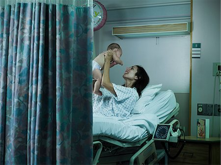 Mother with nerwborn baby in hospital Stock Photo - Premium Royalty-Free, Code: 6114-06600022