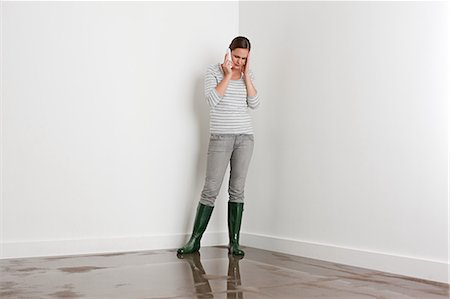 Young woman on flooded floor Stock Photo - Premium Royalty-Free, Code: 6114-06600307