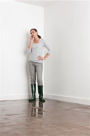 Young woman on flooded floor Stock Photo - Premium Royalty-Free, Code: 6114-06600308