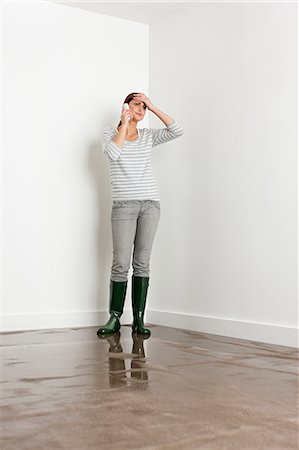 Young woman on flooded floor Stock Photo - Premium Royalty-Free, Code: 6114-06600309