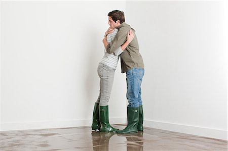 Young couple on flooded floor Stock Photo - Premium Royalty-Free, Code: 6114-06600313