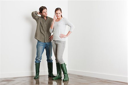 Young couple on flooded floor Stock Photo - Premium Royalty-Free, Code: 6114-06600314