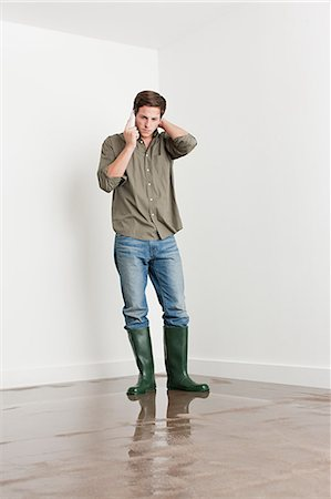 Young man on flooded floor Stock Photo - Premium Royalty-Free, Code: 6114-06600316