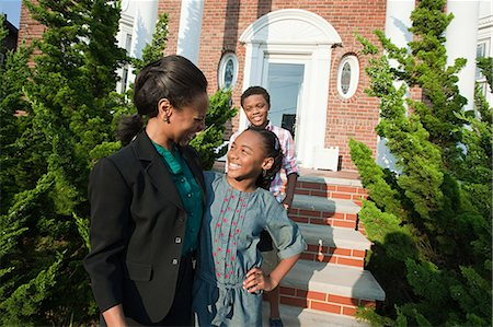 Mother with son and daughter outside home Stock Photo - Premium Royalty-Free, Code: 6114-06600448