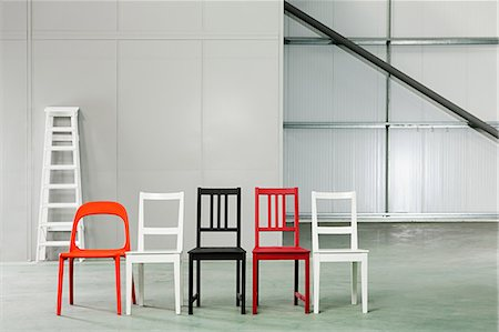 red chair - Five chairs in a row in a warehouse Stock Photo - Premium Royalty-Free, Code: 6114-06600457