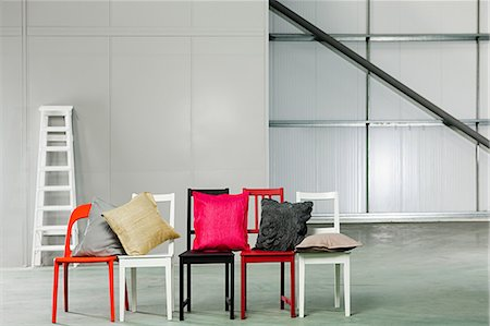 red chair - Cushions and chairs Stock Photo - Premium Royalty-Free, Code: 6114-06600455