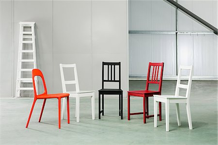 red chair - Five chairs in a warehouse Stock Photo - Premium Royalty-Free, Code: 6114-06600458