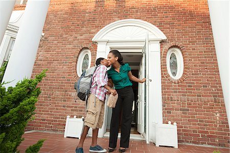 preteen kissing - Mother sending son off with packed lunch in the morning Stock Photo - Premium Royalty-Free, Code: 6114-06600425