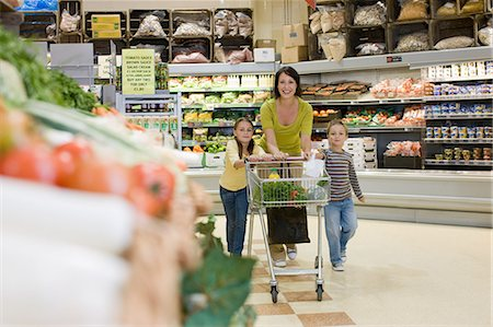 Mother and children in supermarket Stock Photo - Premium Royalty-Free, Code: 6114-06600687