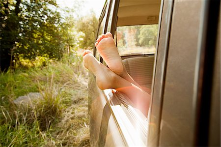 sole - Bare feet sticking out of a car window Stock Photo - Premium Royalty-Free, Code: 6114-06600759