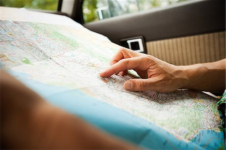 Person with a map Stock Photo - Premium Royalty-Free, Code: 6114-06600789