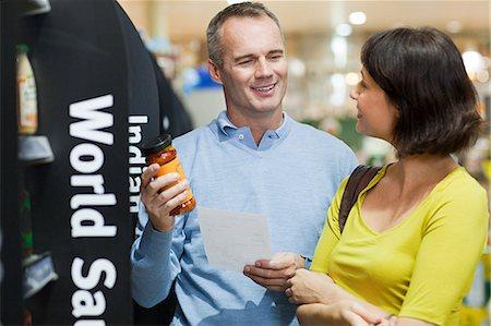 Couple choosing sauce in supermarket Stock Photo - Premium Royalty-Free, Code: 6114-06600718