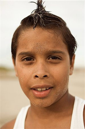 Head and shoulders portrait of boy Stock Photo - Premium Royalty-Free, Code: 6114-06600873