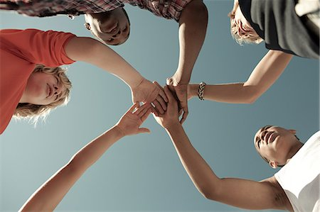 Boys doing huddle, low angle view Stock Photo - Premium Royalty-Free, Code: 6114-06600893