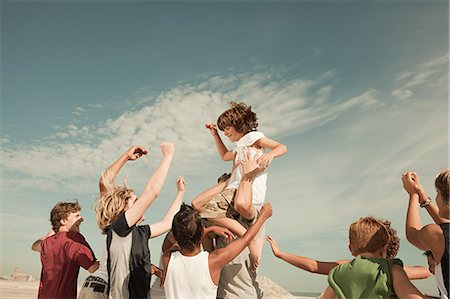 Boy being carried on shoulders Stock Photo - Premium Royalty-Free, Code: 6114-06600895
