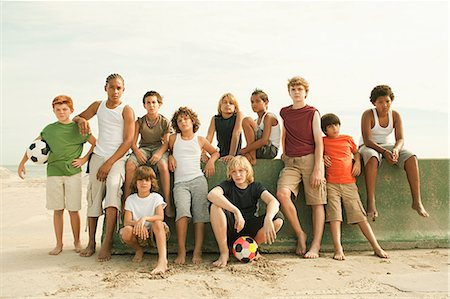 Group of boys by wall with football, portrait Stock Photo - Premium Royalty-Free, Code: 6114-06600801